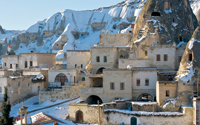 Stone houses built around Goreme's famous fairy chimneys, in winter