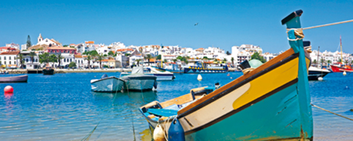 beach and boat in west algarve town