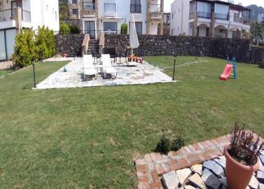 large-garden--four-bed-sea-view-duplex-in-yalikavak