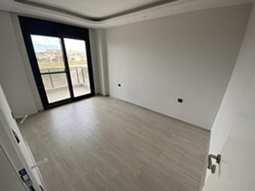 Bedroom-with-balcony-off