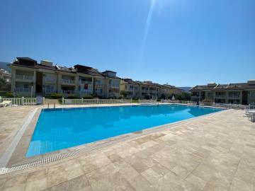 communal-pool-with-sunbathing-areas