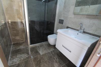 modern-fully-tiled-bathroom