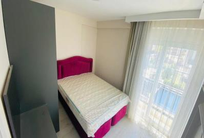 bedroom-with-access-onto-a-balcony