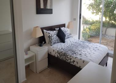 double-bedroom-with-access-to-garden-area