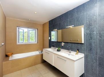 St-Lucia-Homes---CAP128---Allamanda---Livingroom-bathroom