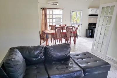 st-Lucia-homes-bea025-livingroom-kitchen