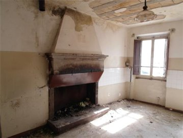 The kitchen w/ stone fireplace