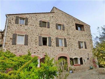 1 - Tordères, Maison de village