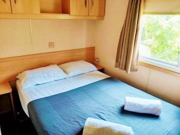 09-Master-bedroom-Plot-M68-Toscana--Caravans-in-the-Sun--1-