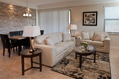 The-Fountains-at-ChampionsGate_4BDRM-Suite_Living_Dining-Area_Angle-2