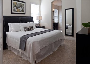 The-Fountains-at-ChampionsGate_4BDRM-Suite_Downstairs-Master-Bedroom_Angle-1