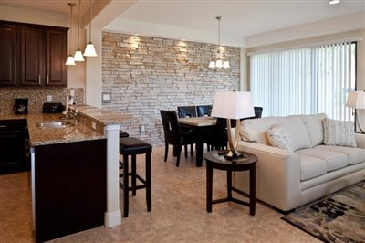 The-Fountains-at-ChampionsGate_4BDRM-Suite_Living_Dining-Area_Angle-1