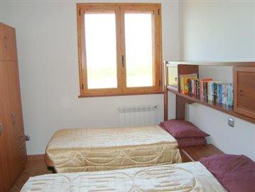 2x Twin bedrooms: Wardrobe; bedside cabinet.