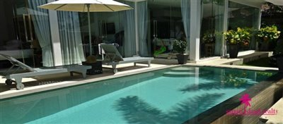 chaweng-modern-pool-villa-for-sale-samui-poolside-sunloungers