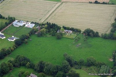 04a2011close-aerial-view-of-house-and-field-r