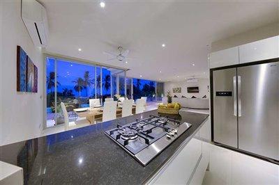 coral-cay-villa-1-kitchen-at-night-1