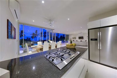 coral-cay-villa-1-kitchen-at-night-1