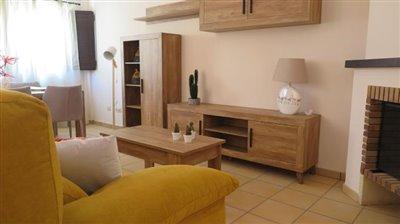 Sit-room-sofa-fireplace-window