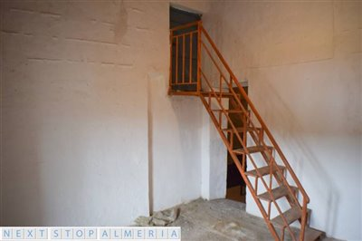 Sixth room and stairs to solarium