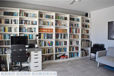 Bedroom 4 currently utilised as a library
