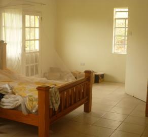 Bedroom-with-veranda-mosquito-net-on-bed-tiled-floor--2-