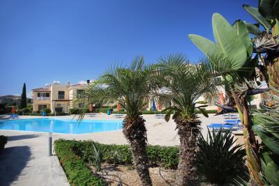 -c-Pafilia-Polis-Gardens-Two-Bedroom-Townhouse-Pool-Area-Palm-Trees