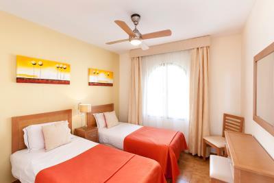 1_Delta_Mar_Suites_Bedroom_06