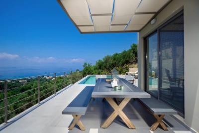 villa-for-sale-in-sfinari-ch158exterior-sitting-area-1