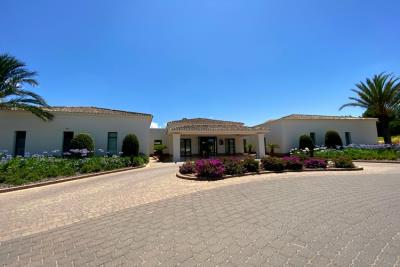 las-colinas-golf-and-country-club---flowers-outside-clubhouse---las-colinas-property-for-sale